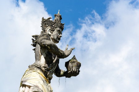 Ancient Hindu sculpture in a temple in Bali, Indonesia