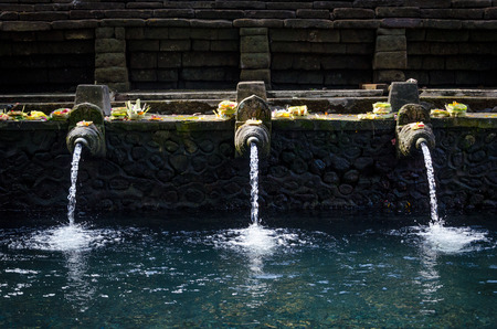 holy fountain in a temple in Bali, Indonesia Stock Photo