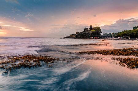 an ancient temple at the shore of pacific ocean in Bali, Indonesia