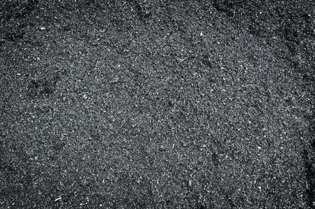 background image of small dark aluminum remnants