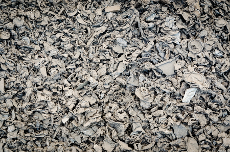 expiration: metal waste in different formed arranged in piles in dark tone