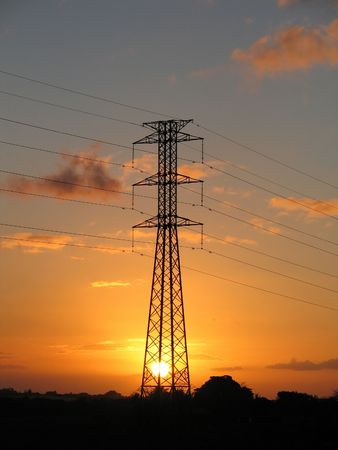 Electrical power pylon over sunset Stock Photo