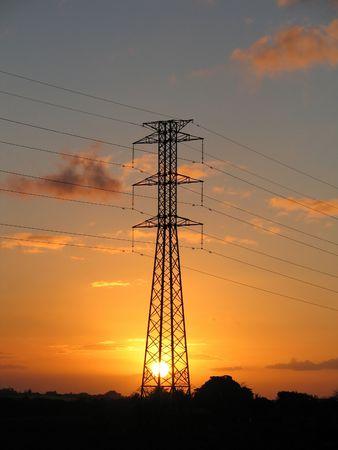 Energia elettrica su pilone tramonto  Archivio Fotografico