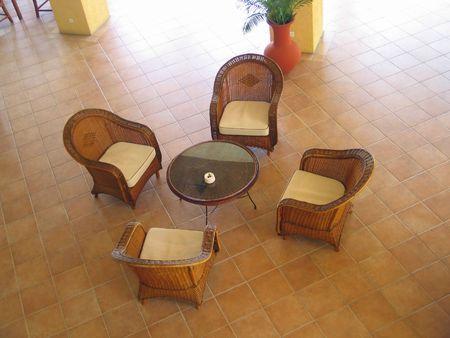 Set of rattan sofa in hotel lobby photo