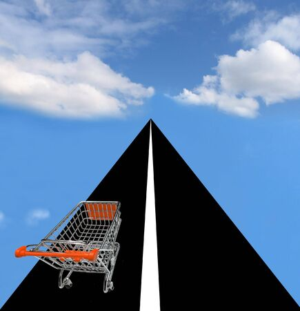 Shopping cart on the road towards the horizon with beautiful sky Stock Photo