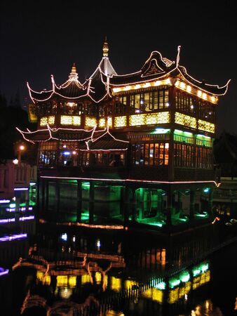 Restaurant in old Shanghai city lit at night Stock Photo
