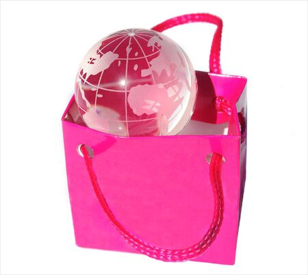 Shopping bag with transparent globe Stock Photo