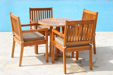 Wooden furniture by the swimming pool