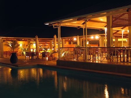 Night shot of resort by swimming pool