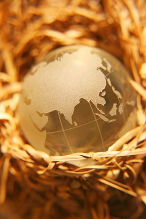 Golden crystal globe on nest- Asian Version Stock Photo - 284629