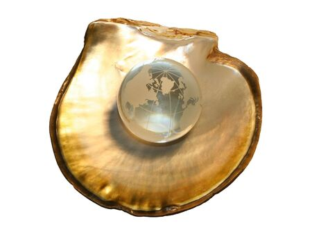 oyster shell: Crystal globe on oyster shell, golden version-concept Stock Photo