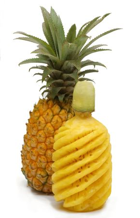 Whole pineapple at back and sculptured one in front