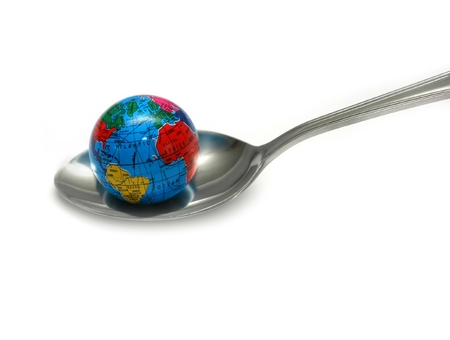 Globe on spoon representing a concept of healing. Stock Photo