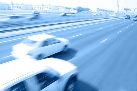 Overtaking movement of vehicles on highway Stock Photo