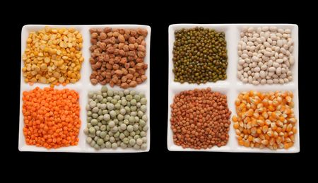 Display of dried food grains isolated background Stock Photo