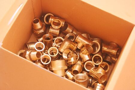 Group of copper brass Plumbing fittings in box Stock Photo