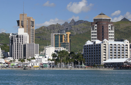 Cityscape of buildings in Port louis Mauritius over mountains background