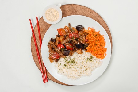 carrot tree: Meat with rice and carrots on a white background closeup