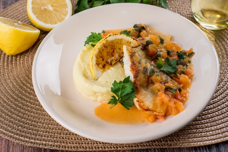 Baked fish with mashed potatoes and steamed spinach