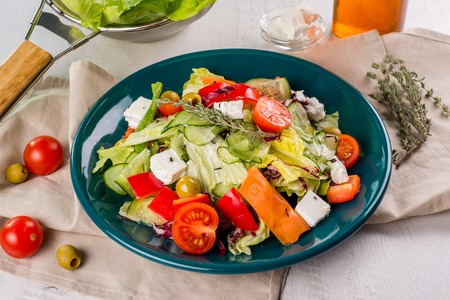 Greek salad in the decoration of a table closeup shot Stock Photo