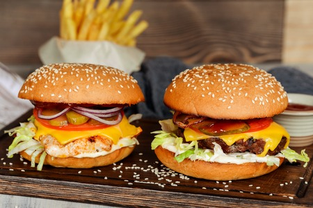 Two cheeseburgers in the decoration closeup shot Stock Photo