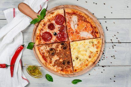 Three cheese pizza on a wooden table close-up shot Stock Photo