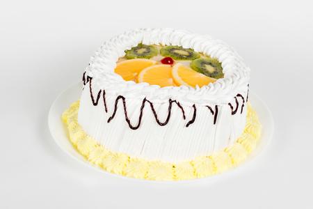 Cake on a white background under the tenderloin filmed in the studio