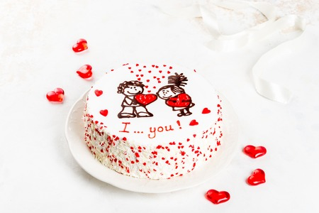 Cake with a pattern of hearts and a pair of lovers. Close-up shot