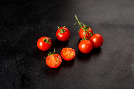 Cherry tomatoes on a black background close-up shot