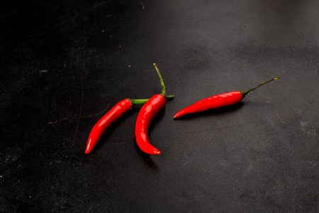 Red pepper shot on black background side view
