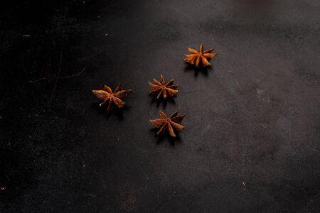 Anise stars shot on a black background