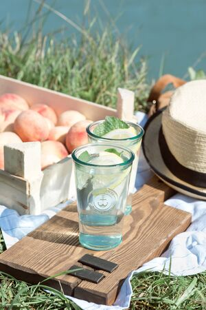Picnic with peach lemonade in sunny weather