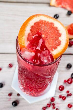 Grapefruit lemonade in a glass transparent glass. Close-up shot.