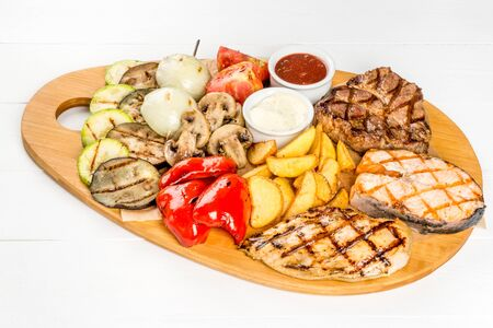 Set for beer from vegetables, meat, grilled fish