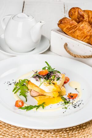 Viennese waffles with egg, tomato, radish on a white wooden background
