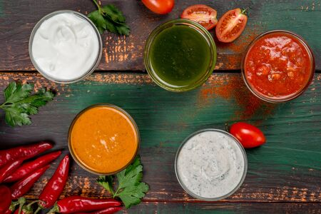 Different types of sauces shot from above on a wooden background Stock Photo