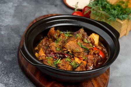 Lamb roast in a black iron plate. Close-up shot