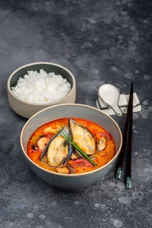 Tom yum soup with seafood rice in the decor. Close-up shot