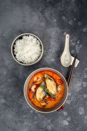Tom yum soup with seafood rice in the decor. Close-up shot Stok Fotoğraf