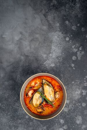 Tom yum soup with seafood rice in the decor. Close-up shot Stock Photo