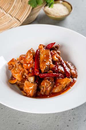 Fried pork ribs in pepper sauce. Close-up shot Stock Photo