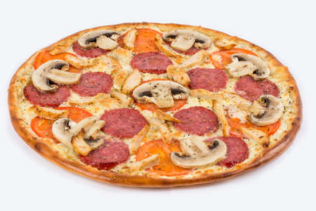 Ready pizza with sausage and mushrooms filmed on a white background