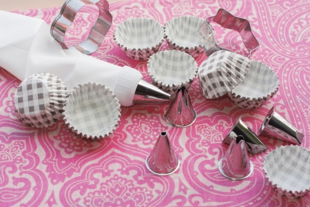 Items to decorate cakes, picks and cutters, on attractive pink background