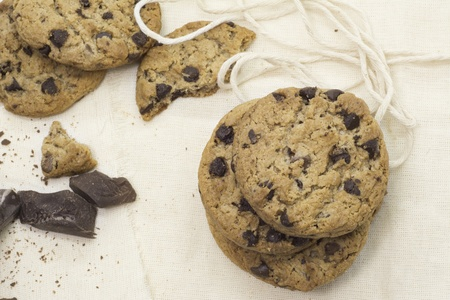 Cookies, pieces of chocolate on rustic tablecloth  Horizontal image Stock Photo - 21927680