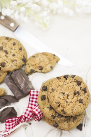 Cookies, pieces of chocolate on rustic tablecloth  Horizontal image photo