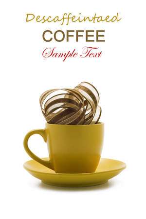 Conceptual series tea and coffees. Decaffeinated coffee. Cup yellow brown belt with transparency, on isolated. vertical position photo