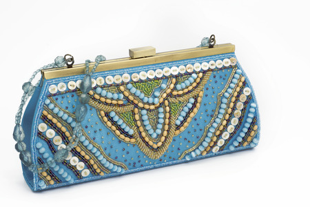 Blue bag holiday, stones embroidery on Isolated background  female accessory photo
