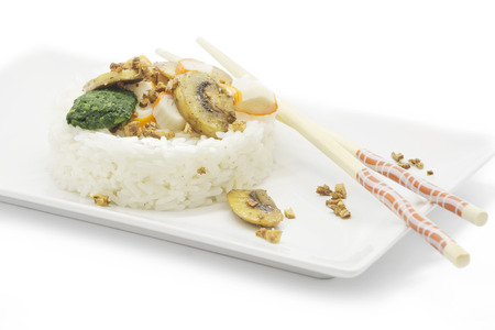 gastronomic: White rice, served in a circular fish with vegetables and mushrooms  white background