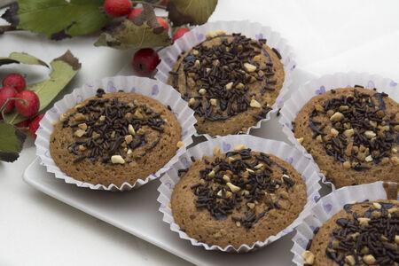 muffin tradicionales, hechos en casa, con chocolate, almendras y decoracion invernal  photo