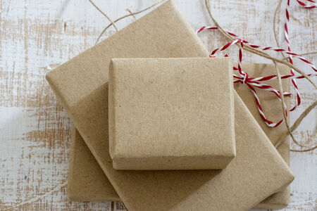 gift box wrapped in recycled paper, with ribbon bow,  with ribbon rustic, red and white